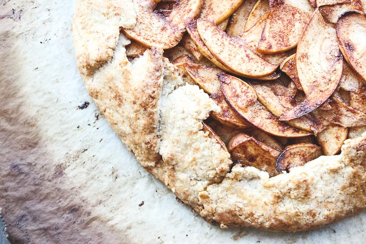 Apple galette with toasted almonds in a flaky cinnamon almond crust. Easier than pie to prepare, rustic and delicious. Perfect fall dessert!