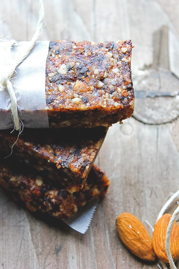 Quick and easy homemade lara bars with almonds, dates and dried cherries. Vegan, gluten free, dairy free. The perfect snack recipe!