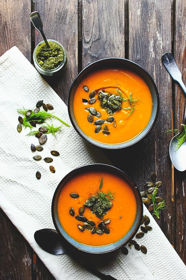 Roasted pumpkin soup with fennel and pumpkin seed pesto. Vegan + gluten free.
