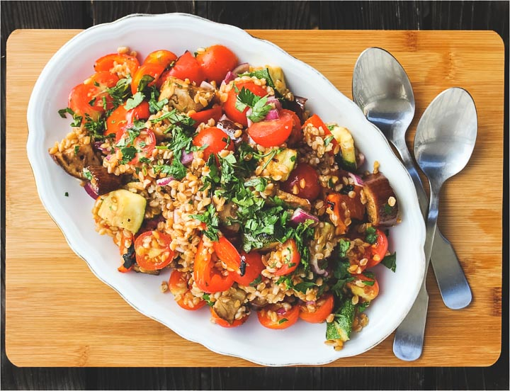 Ratatouille salad made with grilled summer vegetables and spelt berries. Lots of parsley on top. Vegan summer salad, perfect for picnics.