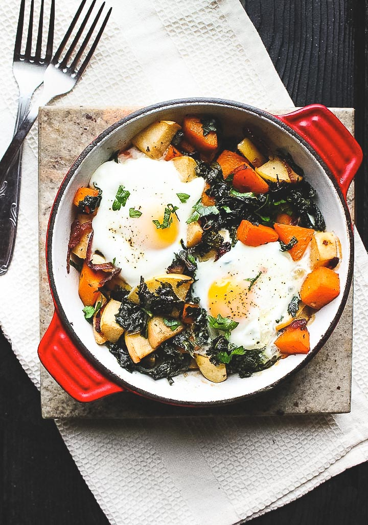 Easy baked eggs with a butternut, apple and kale hash. Perfect for a lazy Sunday brunch or quick and healthy weeknight meal.