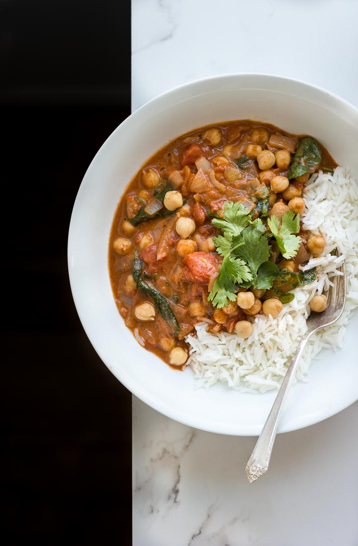 Easy, creamy, vegan chickpea masala with coconut + spinach. A simple, no fuss weeknight meal. Serves 3-4. Gluten free.