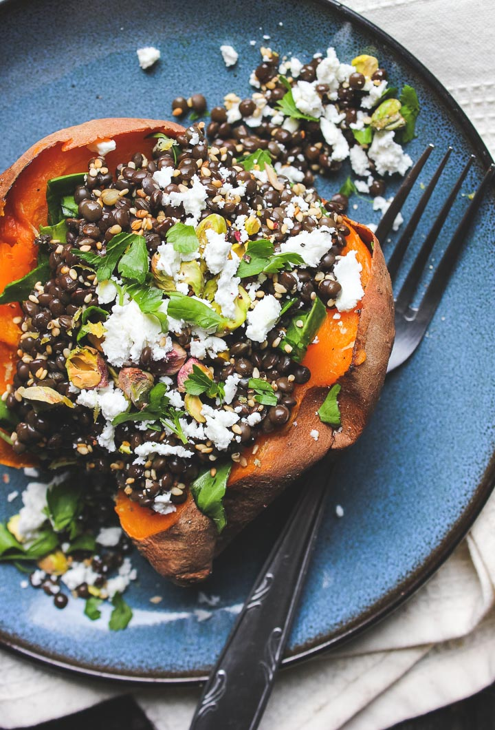 Lentil stuffed sweet potatoes with chard, feta and pistachios. Minimal effort yields big flavour. Gluten free.