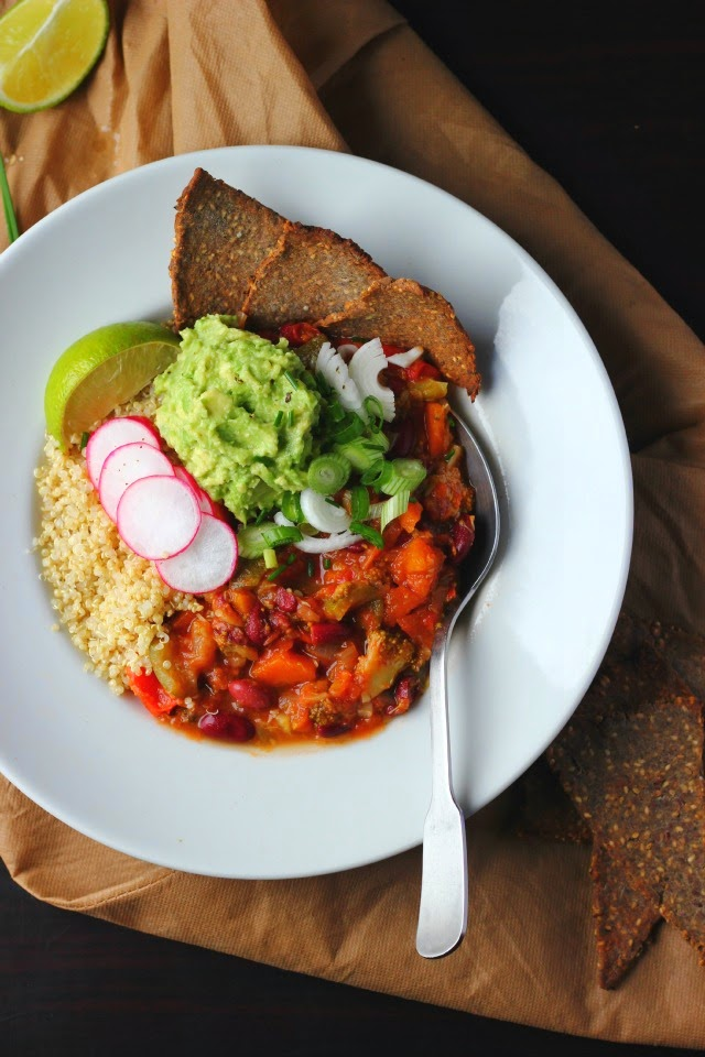 Spring chili with broccoli, zucchini and quinoa. Garnished with avocado, lime, radishes and spring onions. Vegan + gluten free.