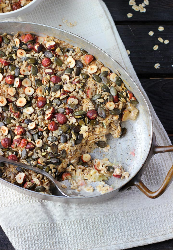 Baked oatmeal with rhubarb and hazelnuts. Made with homemade hazelnut milk, sweetened with maple syrup. Vegan and Gluten Free.