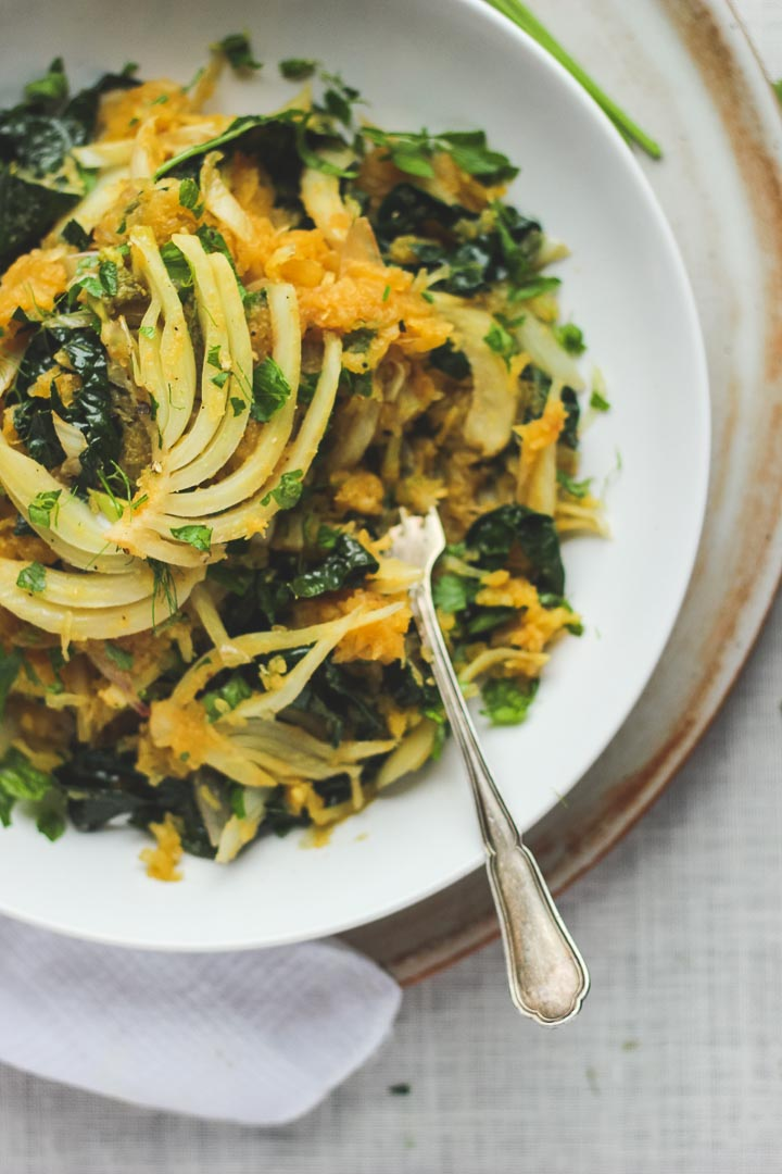 Spaghetti Squash with fresh herbs, roasted garlic, kale, fennel + shallots. Vegan + Gluten Free. Serves 2.