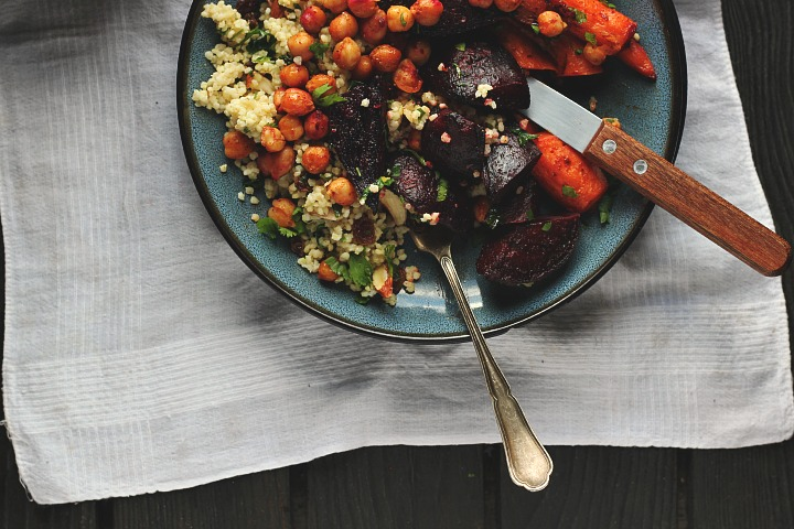 Harissa roasted carrots, beets + crispy chickpeas served with a herby millet pilaf with raisins, almonds and cilantro. Vegan + gluten free. Serves 4.