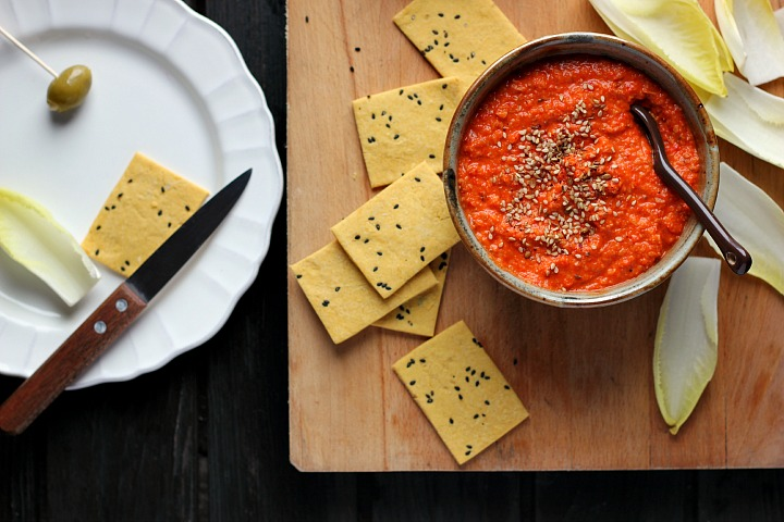 Roasted red pepper dip flavored with toasted almonds and harissa. A spicy, creamy vegan appetizer or snack that is quick and easy to prepare.