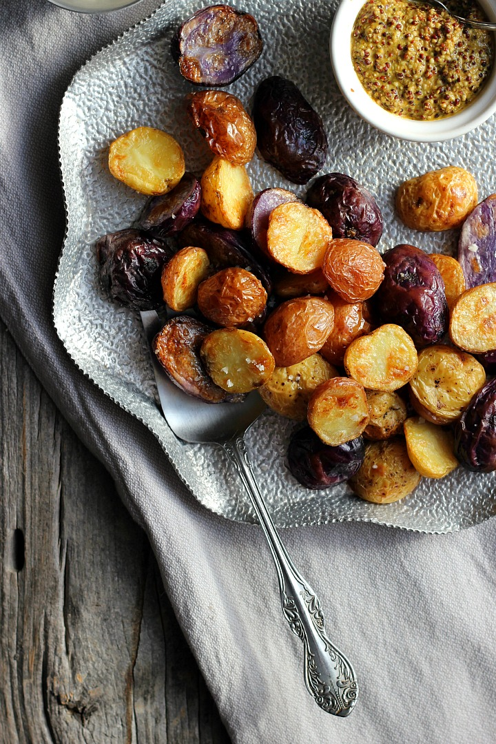 Salt and vinegar roasted potatoes with turmeric honey mustard. Crispy, salty potatoes with a delicious dip. Vegan and gluten free.