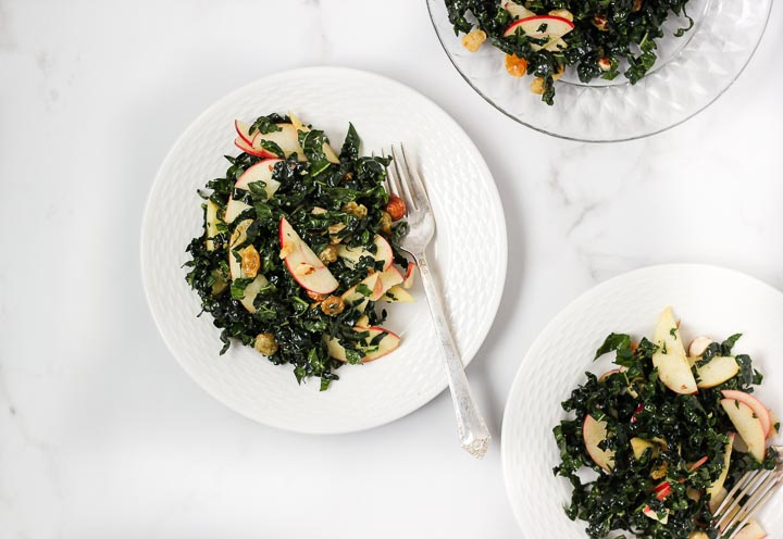 Holiday Kale Salad with Apples, Soaked Golden Raisins and Spiced Cider Dressing
