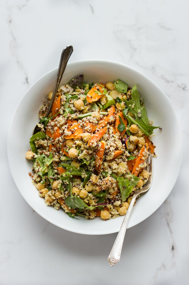Roasted carrot salad with quinoa, chickpeas and almonds. Dressed in a creamy vegan everyday dressing loaded with tahini, dijon and nutritional yeast.