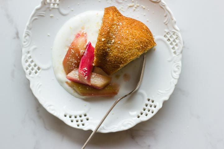 A simple vegan olive oil yogurt cake with maple syrup and vanilla. Topped with maple vanilla roasted rhubarb. A light and fresh spring dessert.