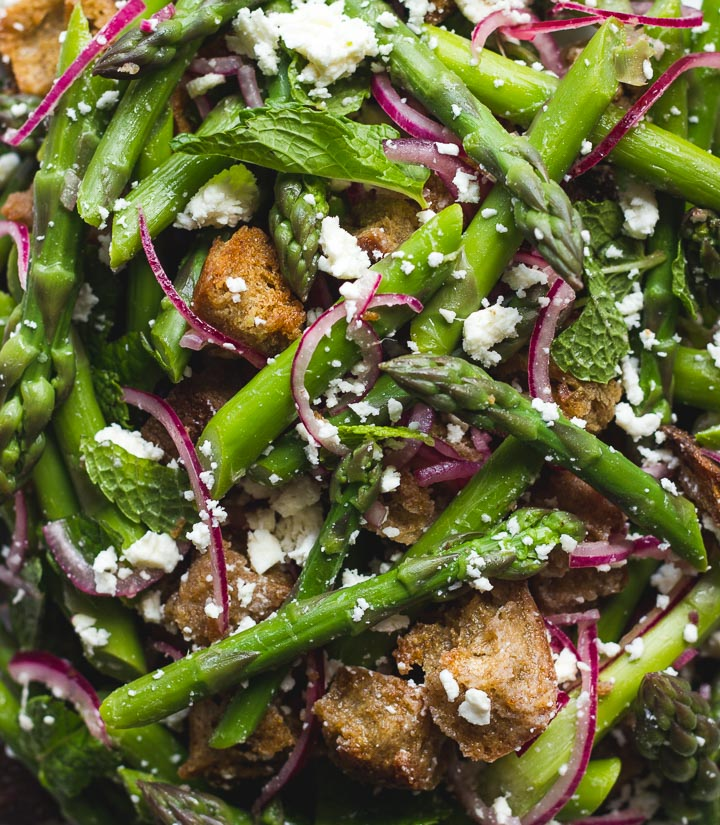 Spring panzanella salad with asparagus, feta and mint from Salt Fat Acid Heat by Samin Nosrat. Perfect spring meal or bbq salad.
