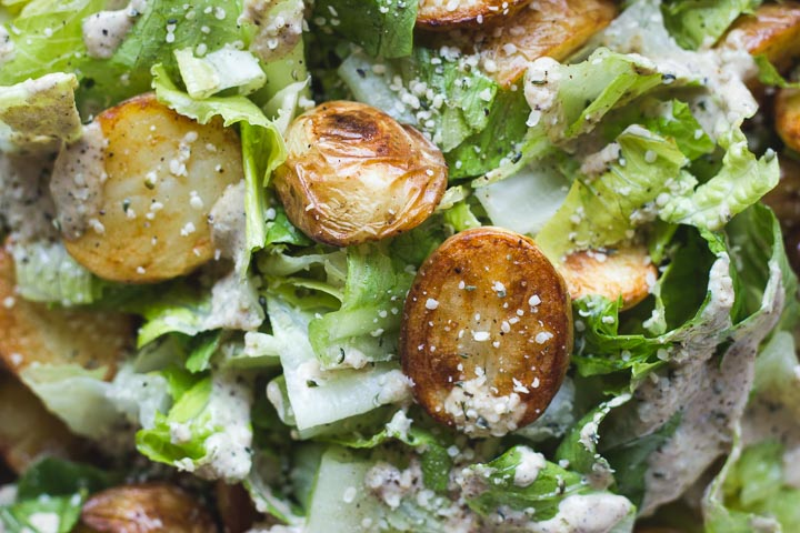 Roasted potato caesar salad with a creamy vegan hemp seed dressing. A gluten free, plant based version of a classic caesar salad.