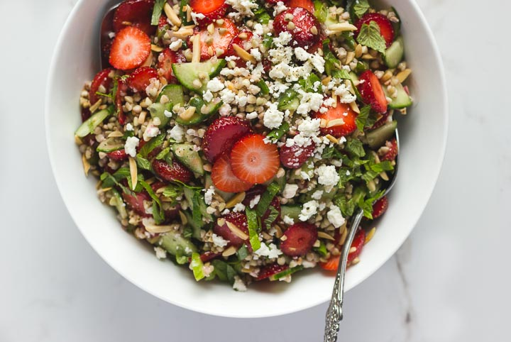 Strawberry buckwheat tabbouleh with cucumber, mint, toasted almonds and feta. Dressed in a simple red wine vinaigrette. Gluten free summer salad.