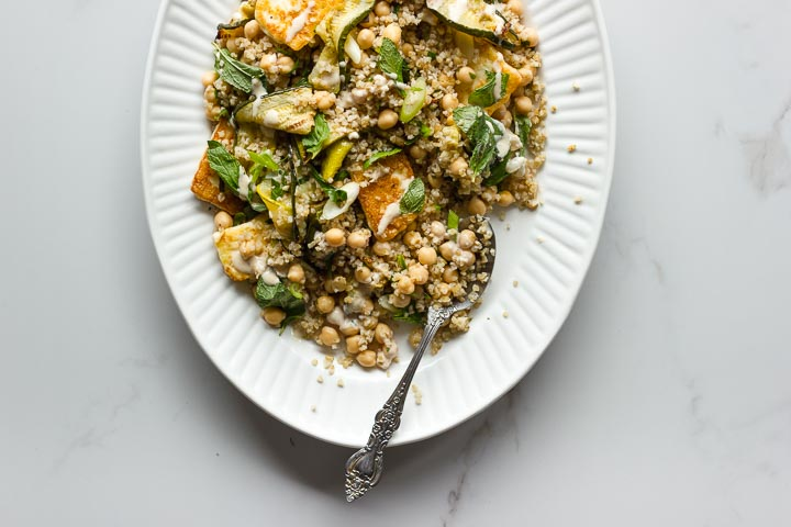 Grilled zucchini salad with halloumi, bulgur and chickpeas. Top with lots of fresh mint and a sweet and spicy tahini dressing. The ultimate summer salad.
