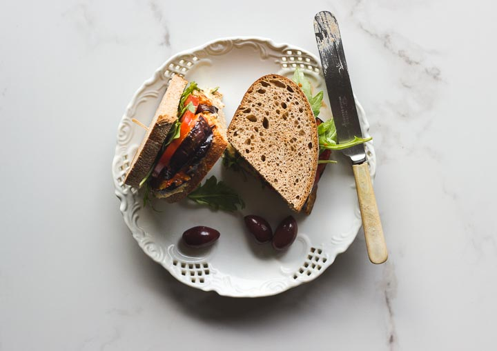 Vegan roasted eggplant sandwhich with hummus and harissa relish. Made with Mina harissa. Simple, quick and easy for lunch or on the go.